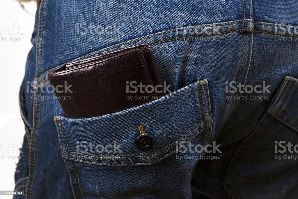 Wallet in a jeans back pocket stock photo