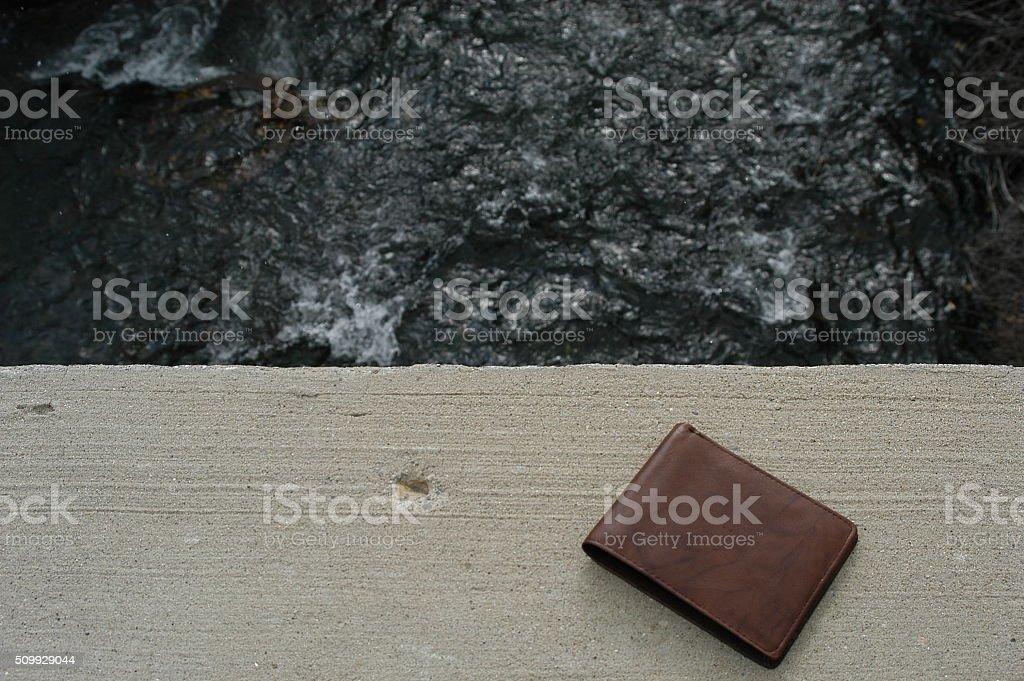 Wallet Left from Bridge Jumper stock photo
