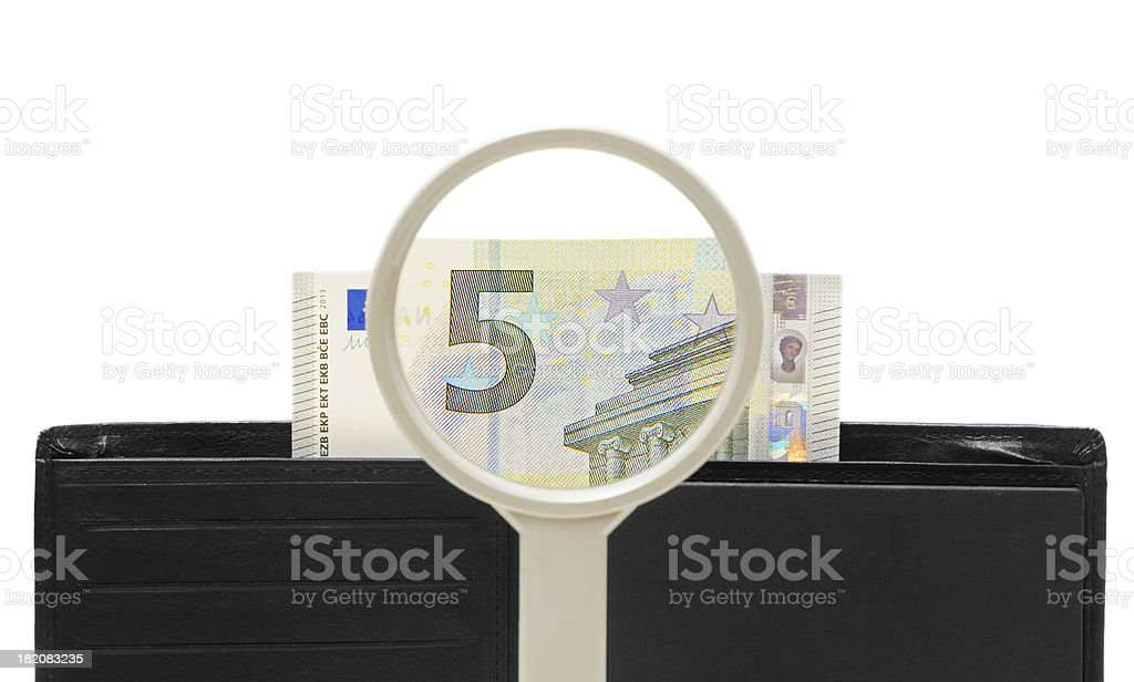 wallet, money under magnifying glass stock photo