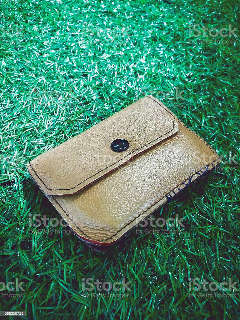 wallet on grass stock photo