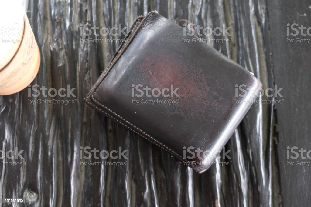 wallet on old wooden board. stock photo