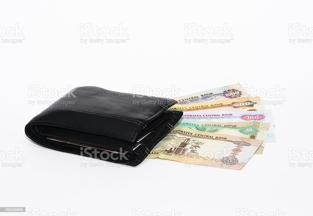 Wallet on UAE currency notes stock photo