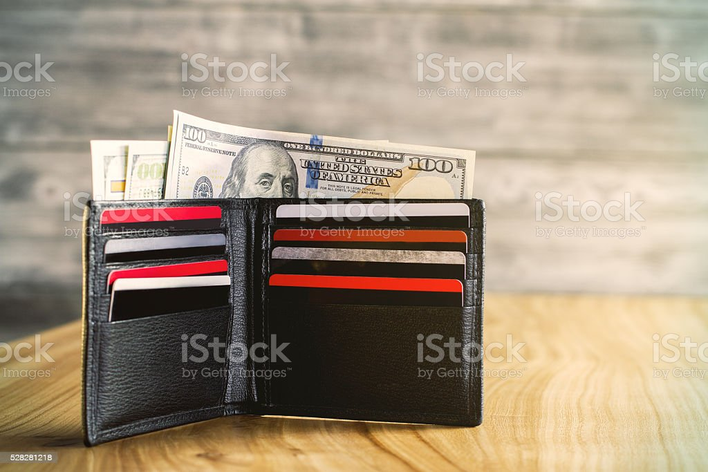 Wallet with dollars and cards stock photo