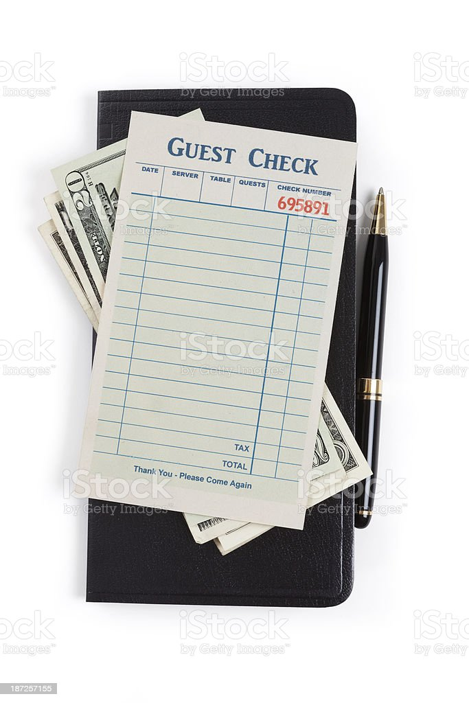 Wallet with dollars, pen and blank guest check stock photo
