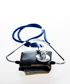 Wallet with stethoscope against white background