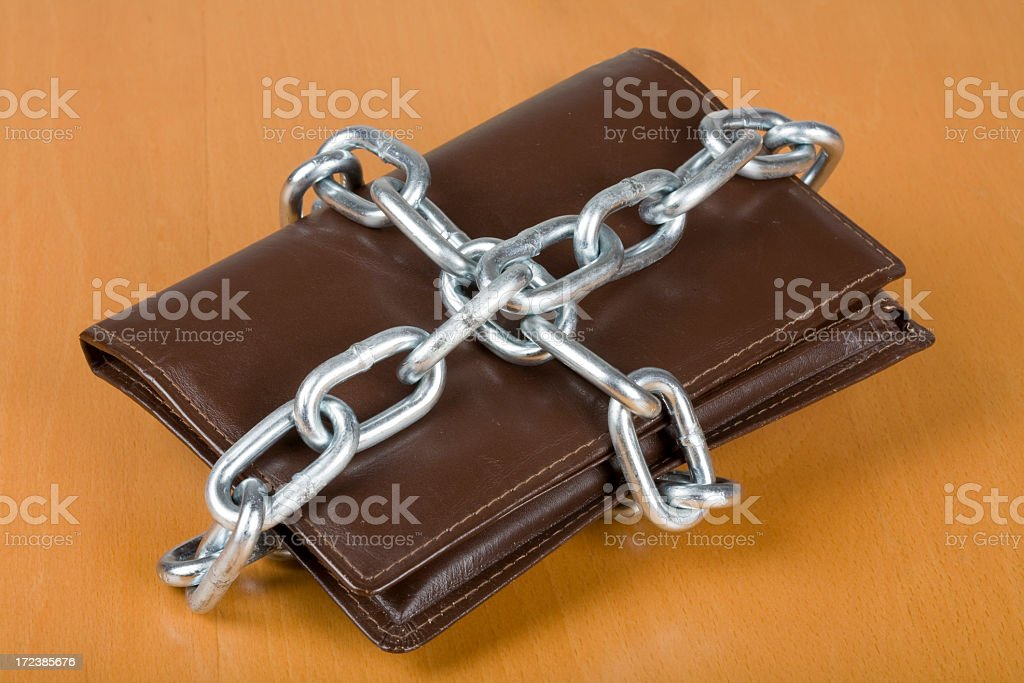 Wallet wrapped in chain royalty-free stock photo