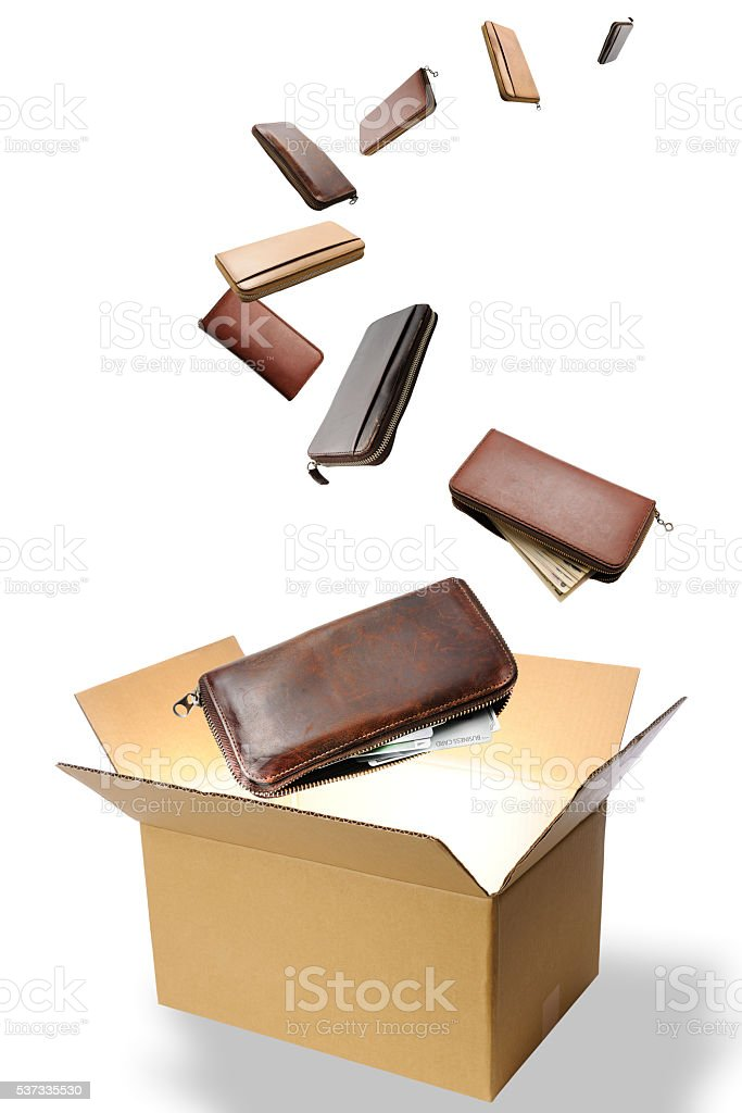 Wallets run away from a inside bright cardboard box stock photo