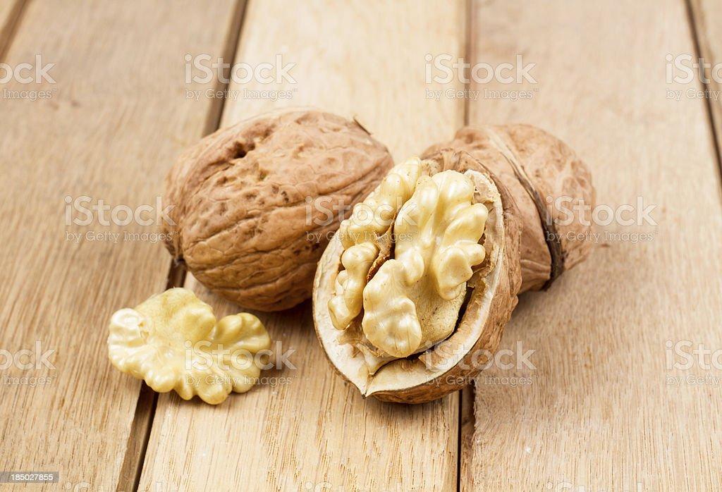 Wallnuts on a wooden board royalty-free stock photo