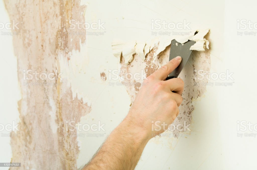 Wallpaper stripping royalty-free stock photo
