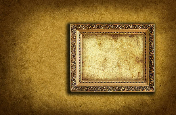 wallpaper with empty picture frame stock photo