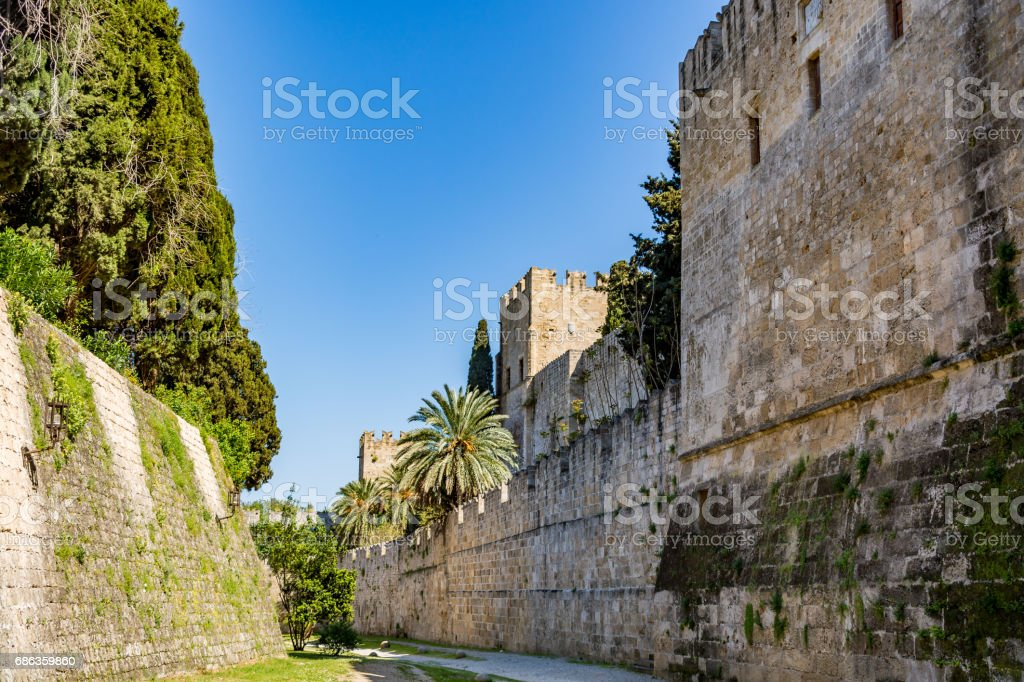 Walls of Rhodes old town and moat close to the Palace of the Grand Master, Rhodes island, Greece stock photo