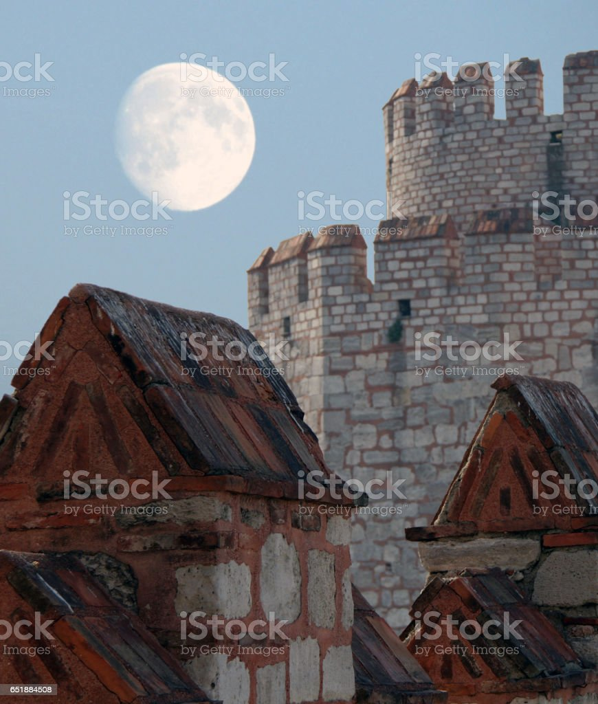 Walls of Yedikule Zindanlari (Fortress of the Seven Towers) on a background of fool moon, Fatih, Istanbul, Turkey stock photo