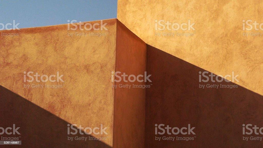 Walls with geometric shadows stock photo