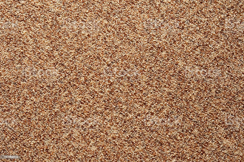 Wall-to-wall carpet loop fabric speckled brown pattern full frame stock photo