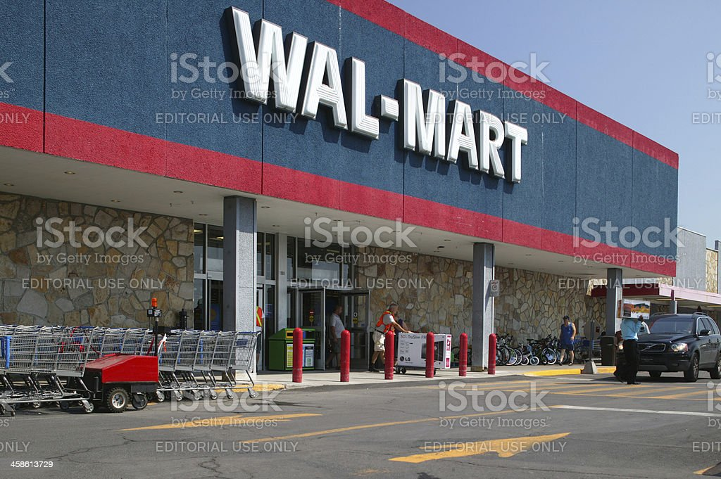 Walmart storefront from parking lot stock photo