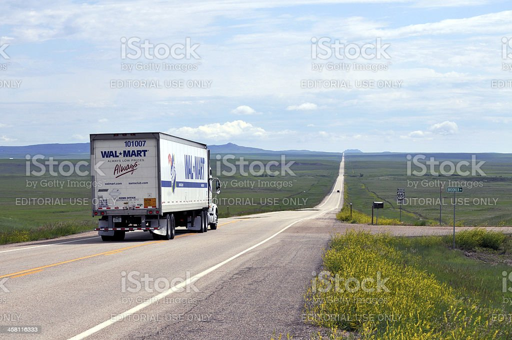 Wal-Mart truck driving into the horizon stock photo