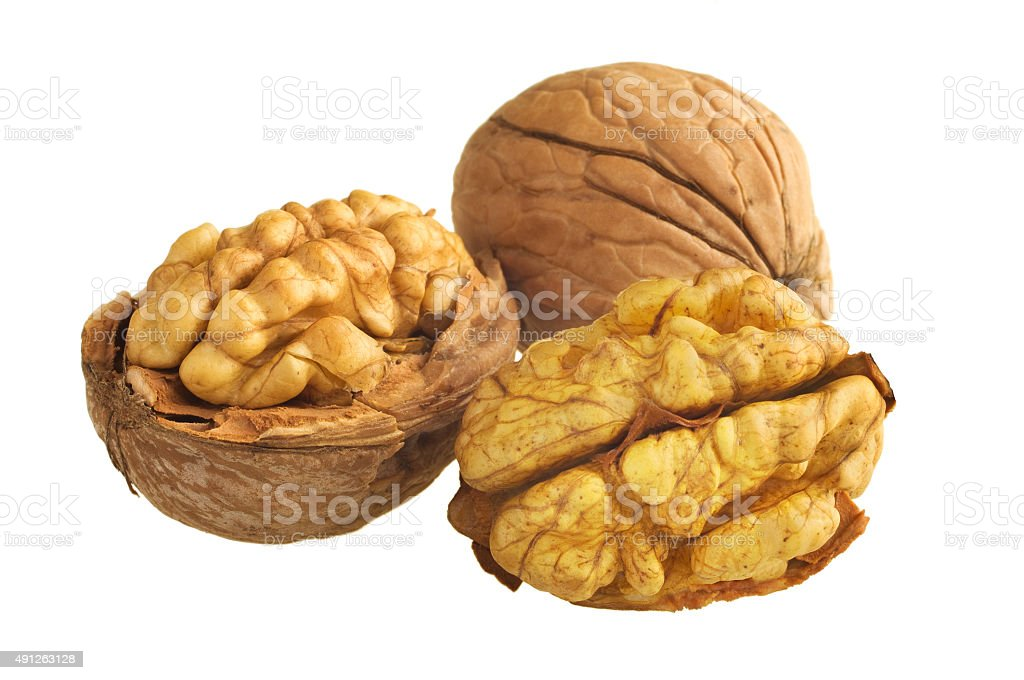 walnut and a cracked walnut isolated on the white background stock photo