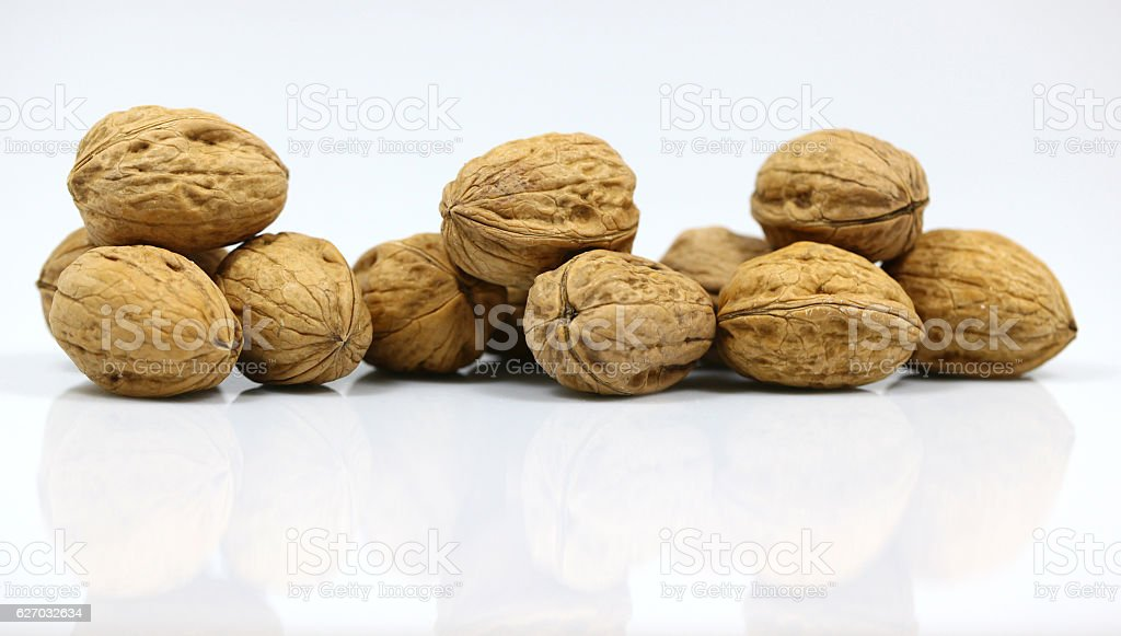 Walnut and a cracked walnut on the white background stock photo