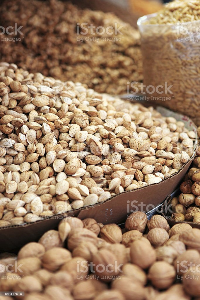 walnut and almonds stalls royalty-free stock photo