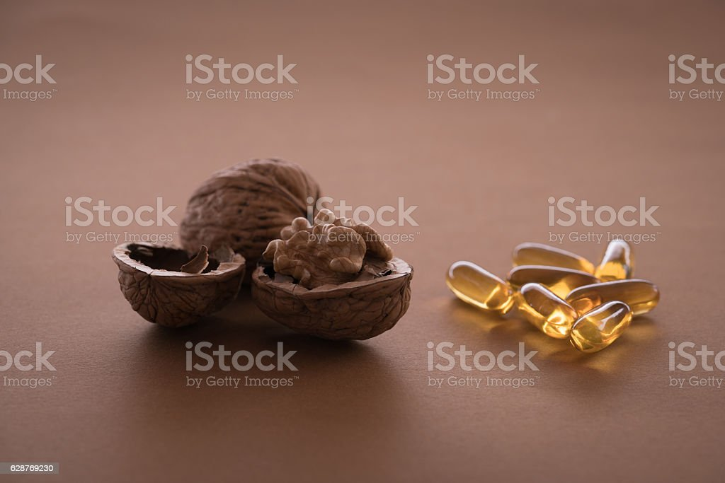 walnut and supplement stock photo