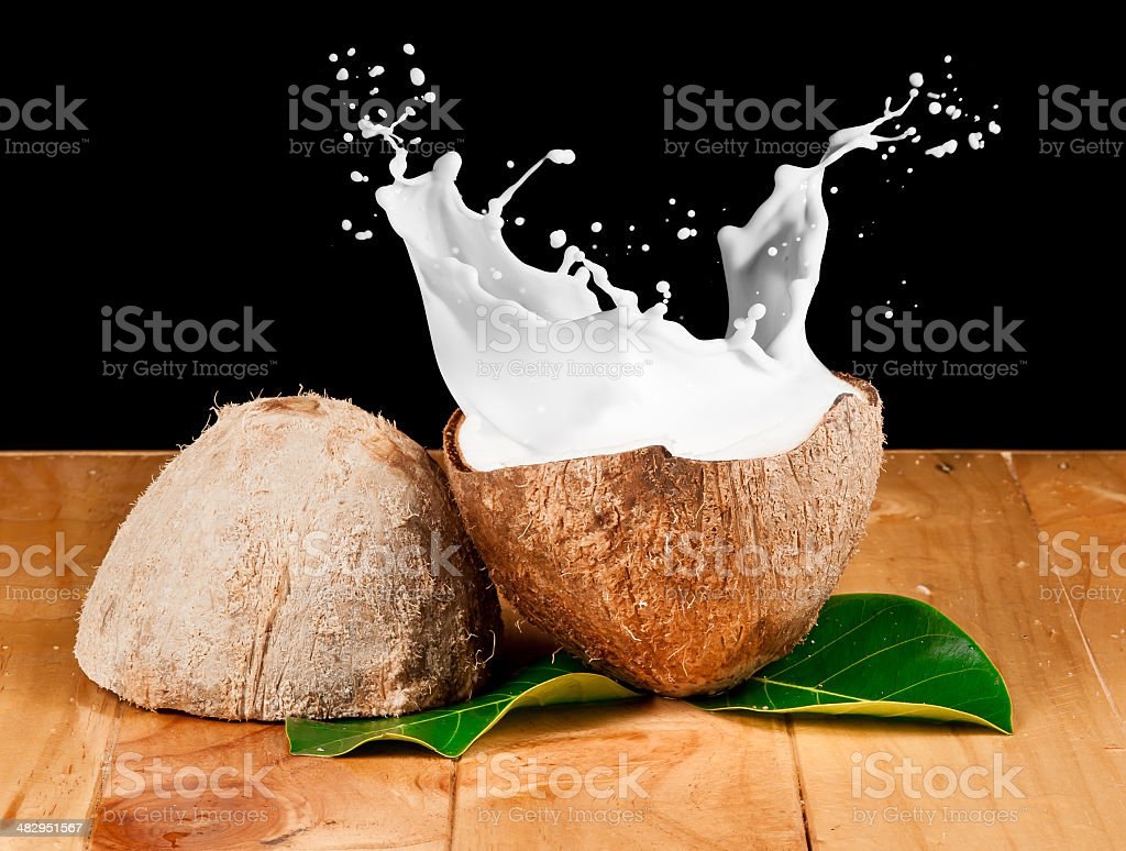 walnut coconut milk on wood stock photo