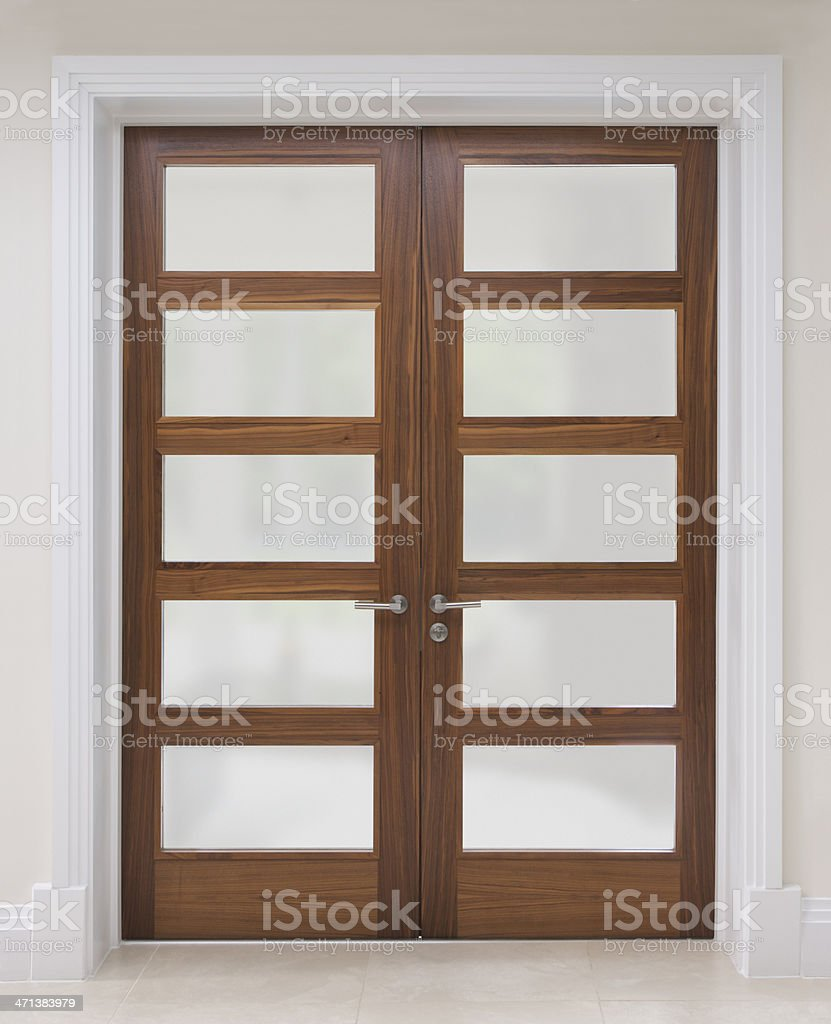 walnut doors with frosted glass stock photo