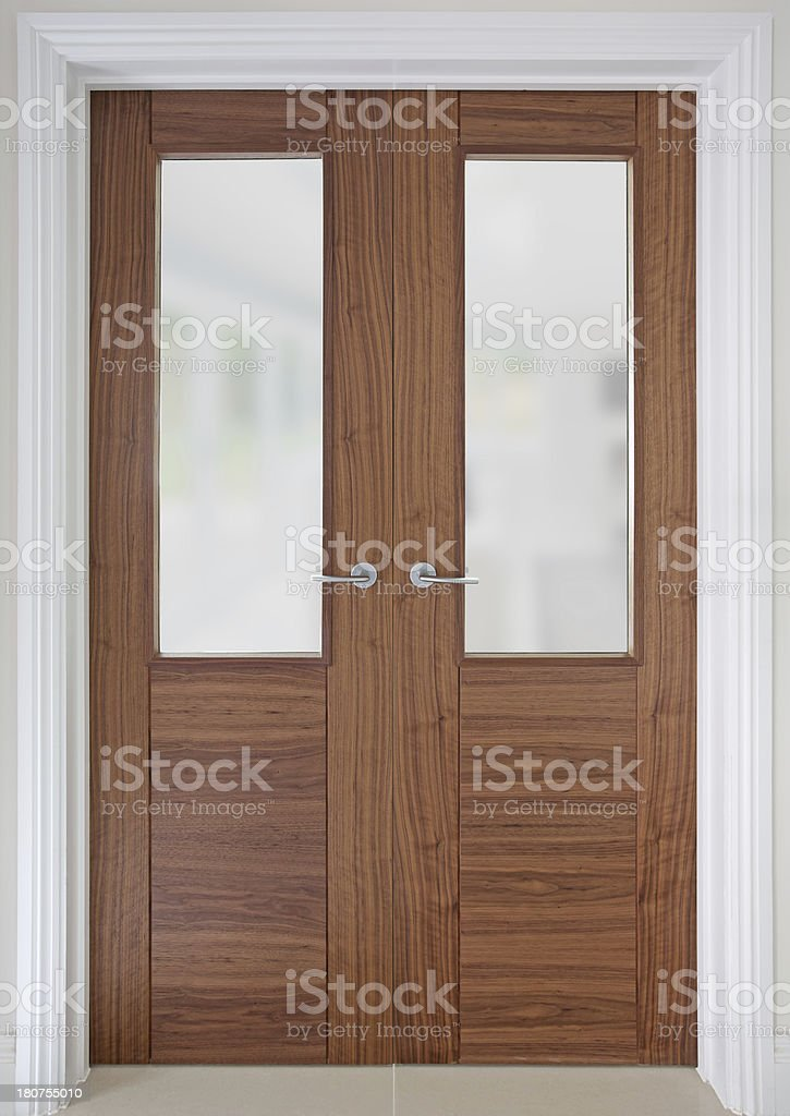 walnut doors with opaque glass panels stock photo