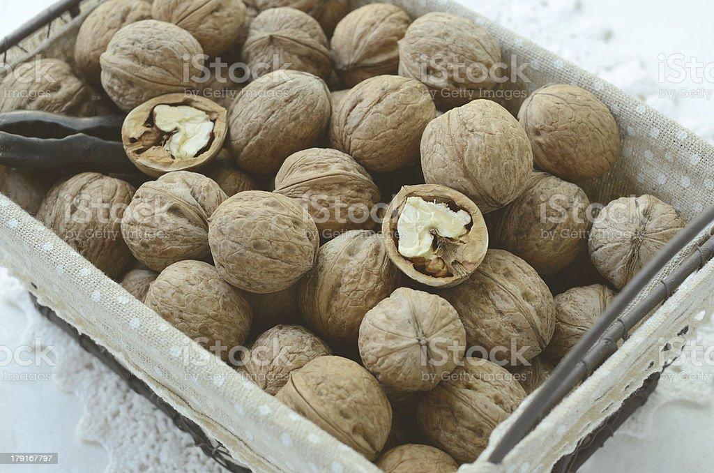 Walnut in wire basket royalty-free stock photo