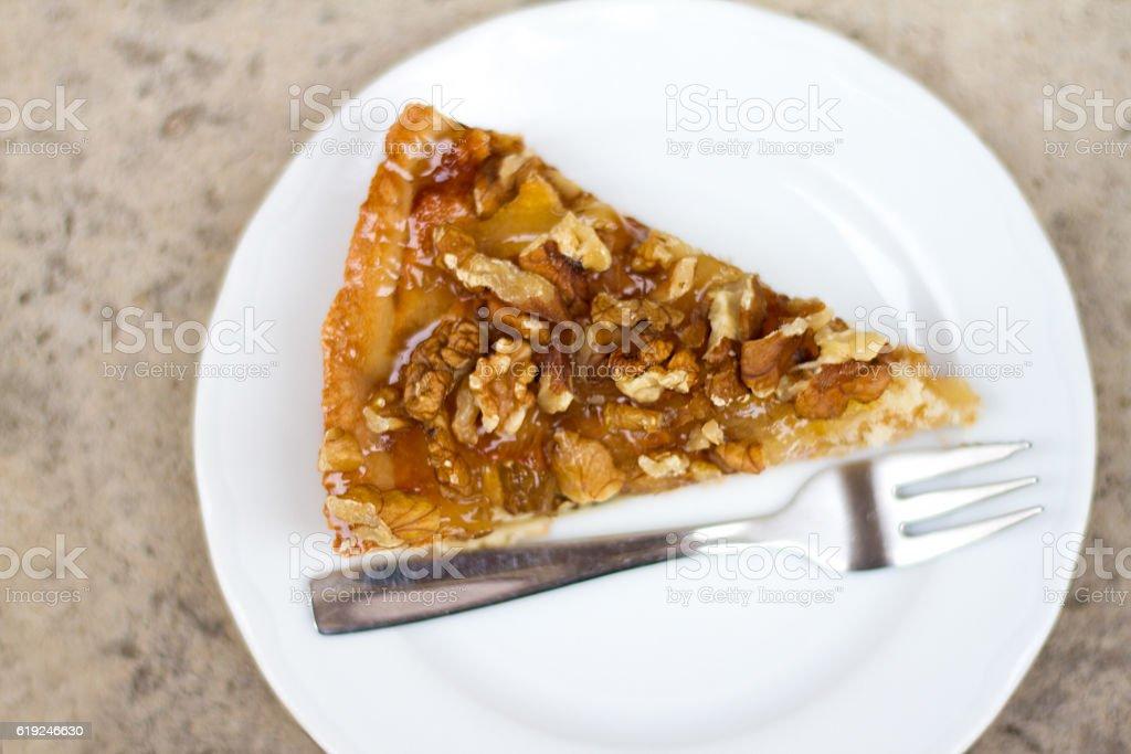 Walnut-Apple Pie Slice with Fork stock photo