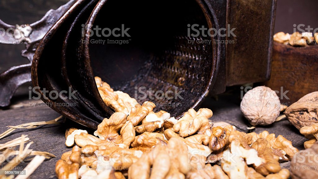 Walnuts and hand walnuts grinder stock photo