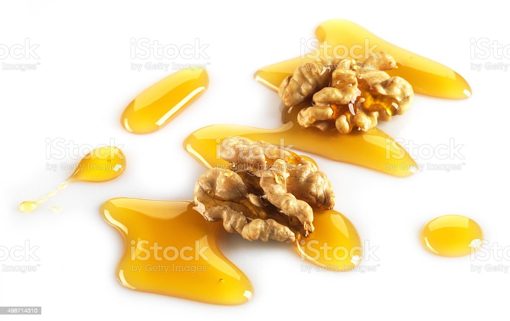 walnuts and maple syrup stock photo