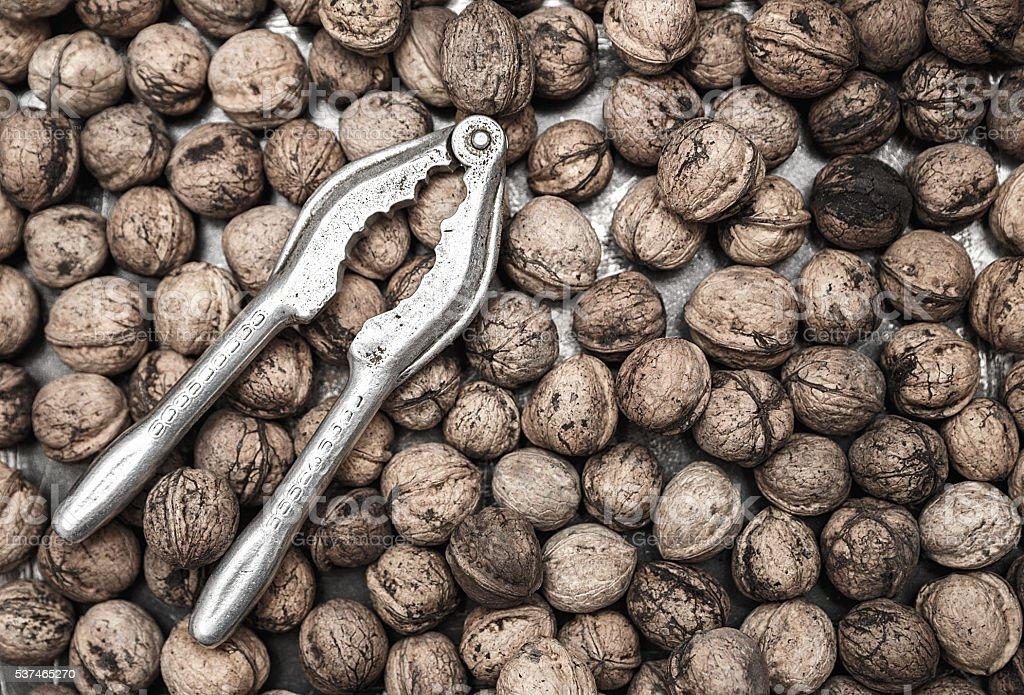 Walnuts and nutcracker stock photo