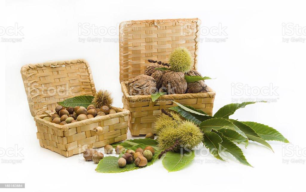 walnuts, chestnuts, hazelnuts in a wicker basket royalty-free stock photo