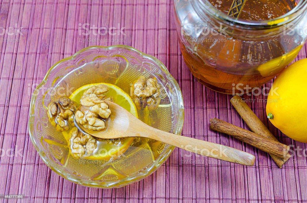 Walnuts honey and lemon on a table royalty-free stock photo