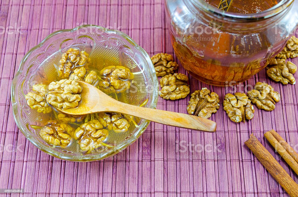 Walnuts honey and on a table royalty-free stock photo