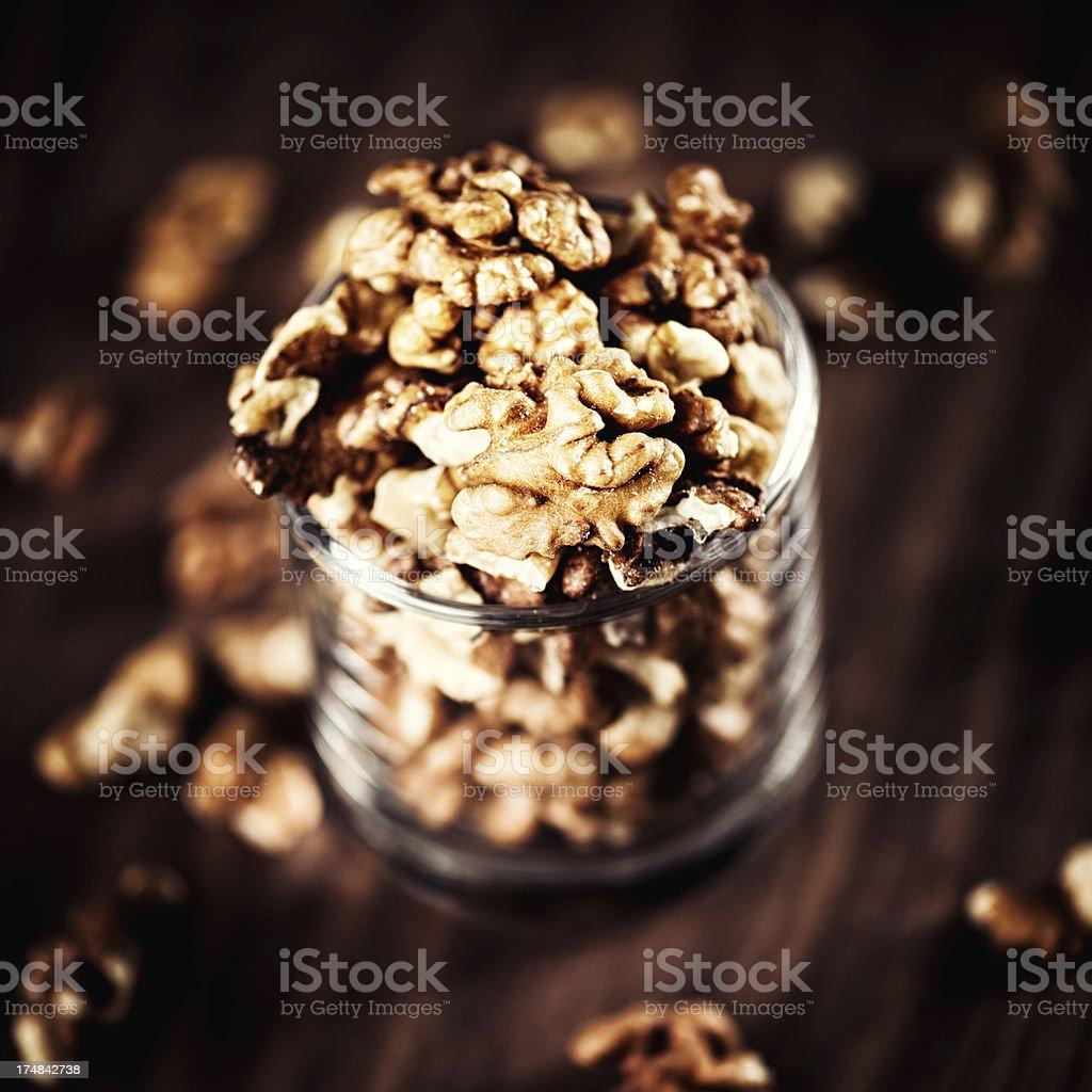 Walnuts in a glas jar royalty-free stock photo