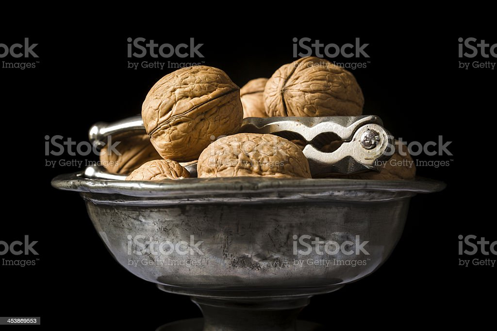 Walnuts in pewter bowl stock photo