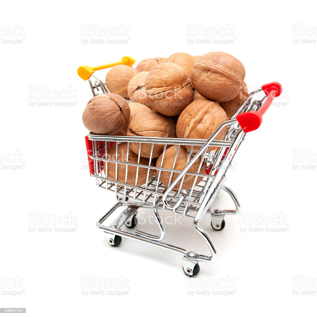 Walnuts in shopping cart isolated on white background stock photo