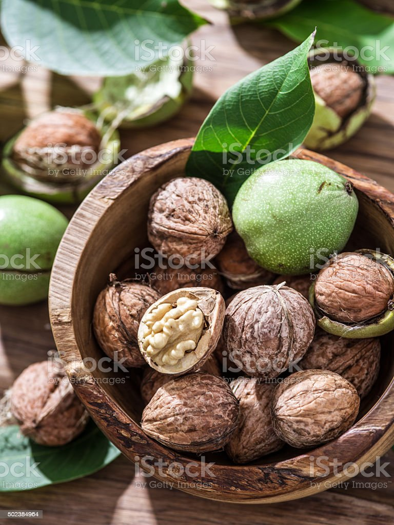 Walnuts in the wooden bowl. stock photo