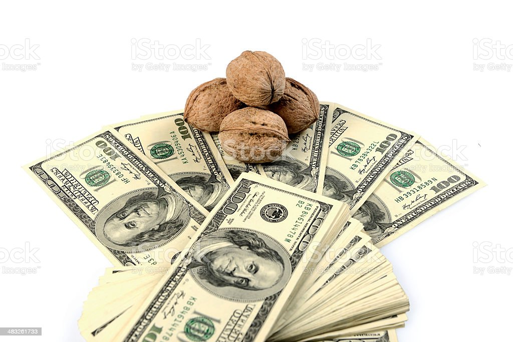 Walnuts investment with US 100 dollars royalty-free stock photo