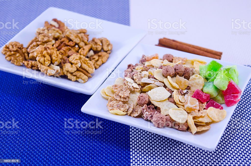 Walnuts, muesli and cinnamon sticks royalty-free stock photo