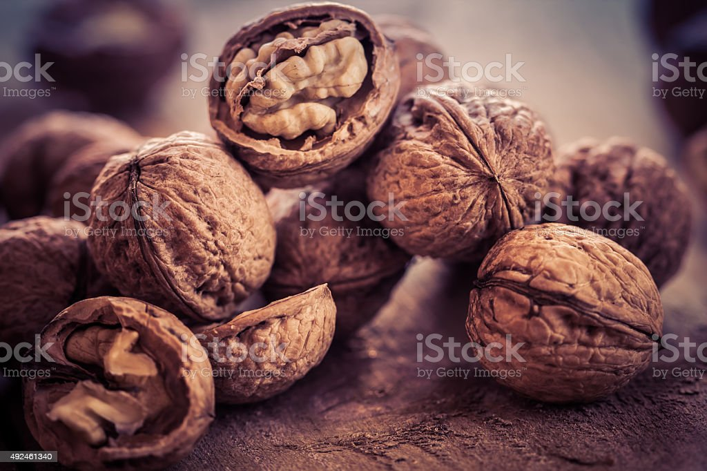 Walnuts on a wooden table. stock photo