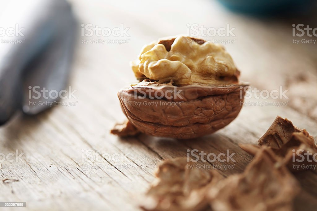 Walnuts on a wooden table stock photo