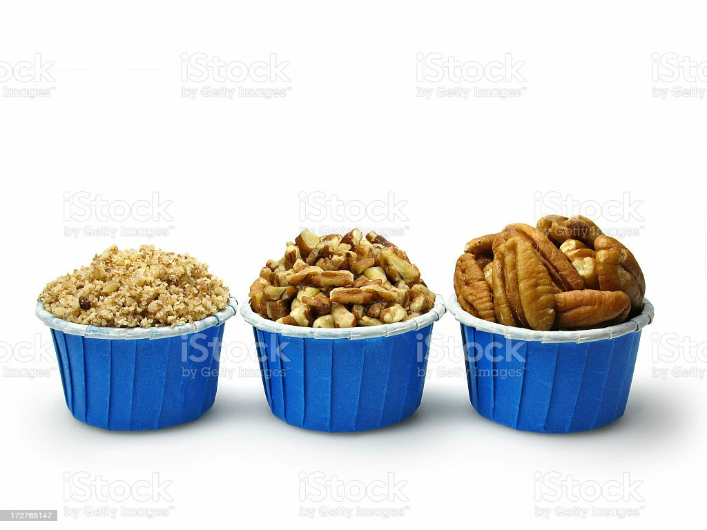 Walnuts: whole, loosely and finely chopped stock photo