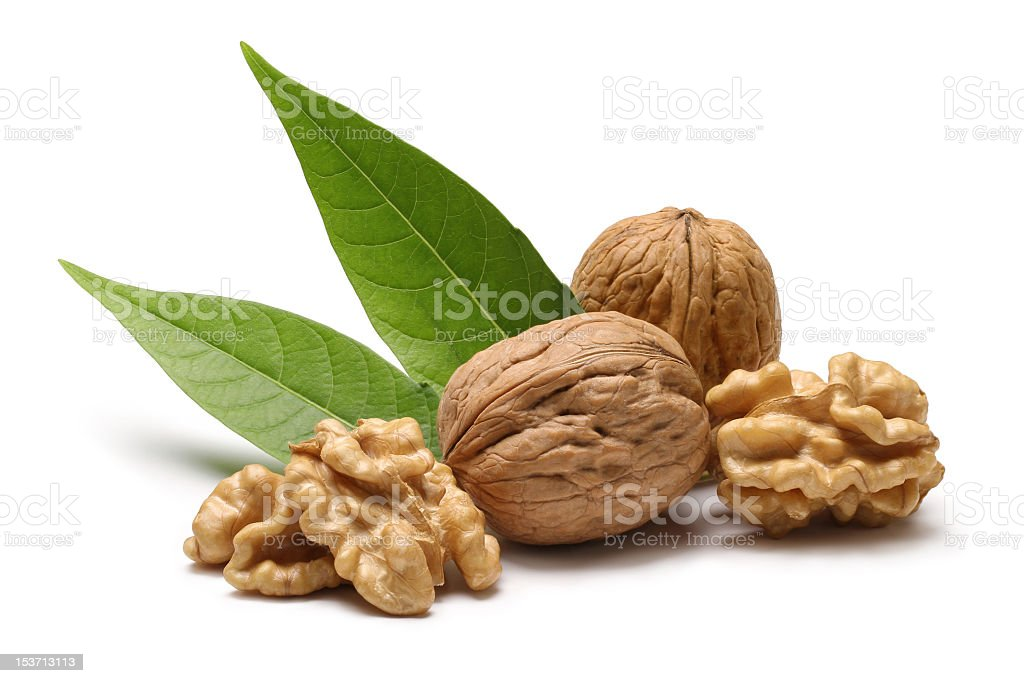 Walnuts with leaves isolated on white background stock photo