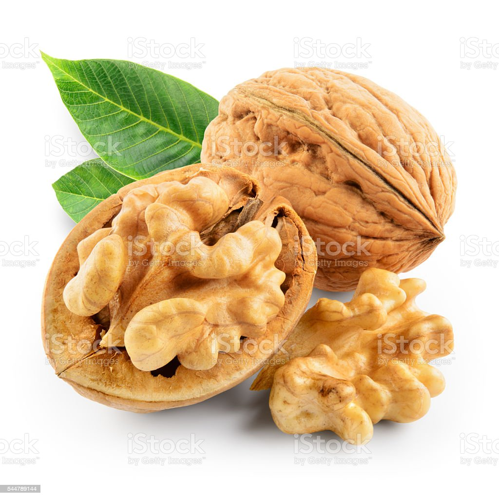 Walnuts with leaves isolated on white. With clipping path. stock photo