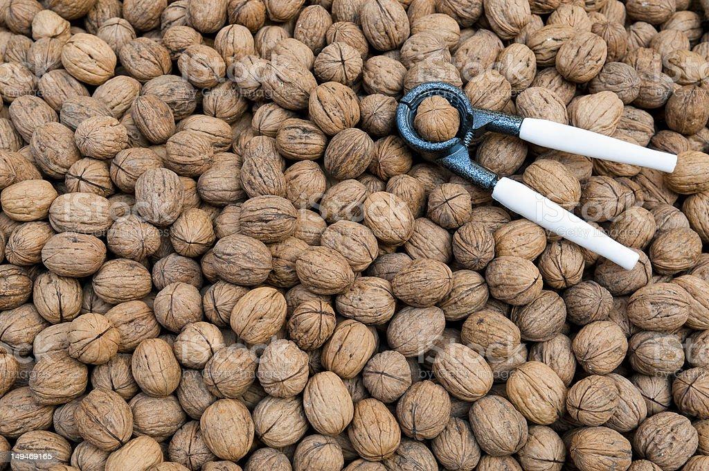 Walnuts with nutcracker stock photo