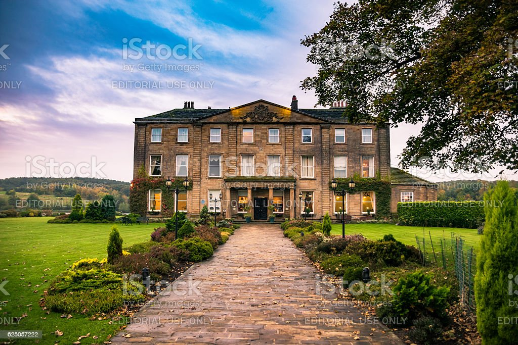 Walton Hall in a scenic setting of rolling parkland. stock photo