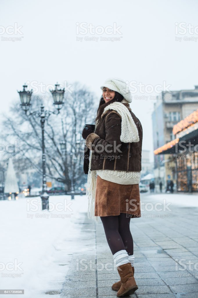 Waman on the street smiling at camera stock photo