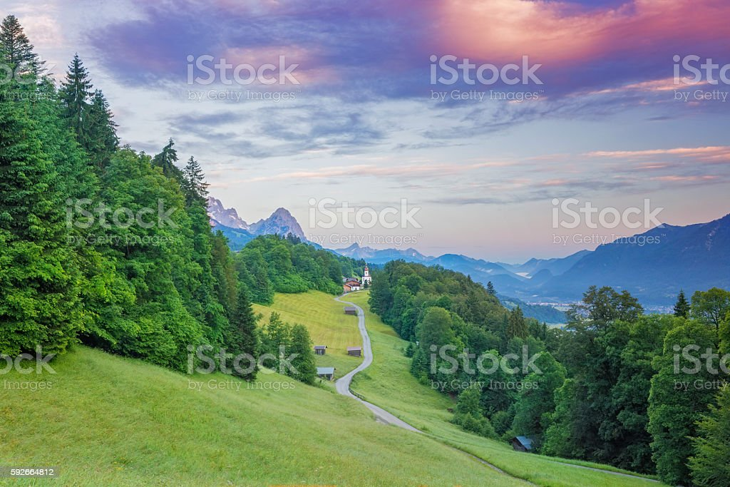 Wamberg, the highest village with church in Germany at sunset stock photo